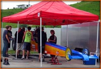 Mark Vincent top Alcohol Dragster under the awning