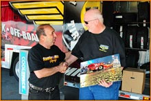 Camp Stanley presented Mickey Thompson Motorsports Manager Carl Robinson A Pro Mod Photo Recognition Award