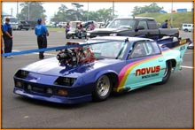 Mike Evans Of Novus Windscreens Racing Camaro